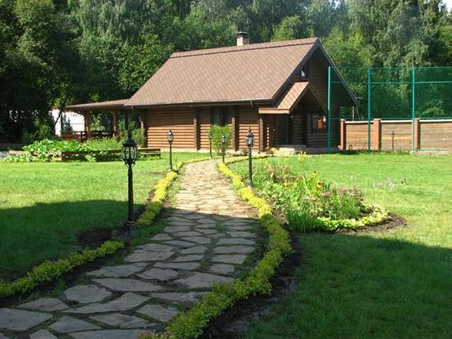 загородный дом из оцилиндрованного бревна